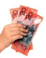 hand holding $20 Aus notes